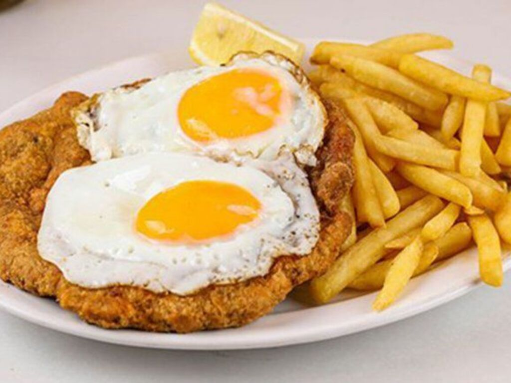 https://elsol-compress-release.s3-accelerate.amazonaws.com/images/large/1614296501390milanesa%20con%20huevos.jpg